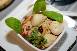 Dumplings, noodles, greens in Hot Pot.