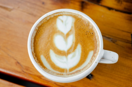 A latte from Commonplace Coffee inside Smallman Galley